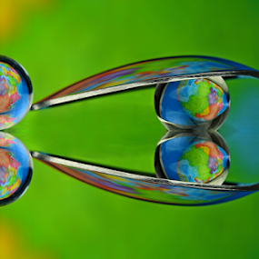 by Dipali S - Artistic Objects Other Objects ( abstract, fork, reflection, color, colorful, still life, art, artistic, spoon, spheres, refraction, globe )