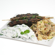 Ground Lamb Kofto Kebabs with Pomegranate Glaze, Bengali-Spiced Potatoes and Persian Cucumber Raita