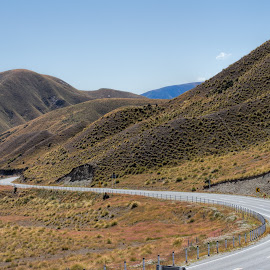The road winds on by Vibeke Friis - Transportation Roads ( hills, winding road, blue sky, desert,  )