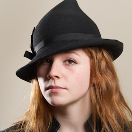Redhead serious in black hat and jacket by Nick Dale - People Fashion ( jacket, girl, woman, redhead, serious, leather, portrait, black, necklace, hat )