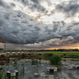 Stormy sunset by Adam Evetts - Landscapes Weather ( clouds, orange, gloucestershire, tewkesbury, river avon, sunset, landscape )