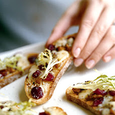 Frisée Salad with Blue Cheese, Walnut, and Cranberry Crostini