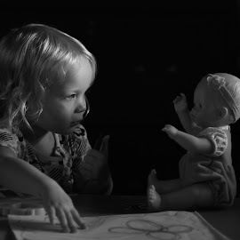 Teaching by Troy Wheatley - Babies & Children Children Candids ( child, doll, girl, black and white, young,  )