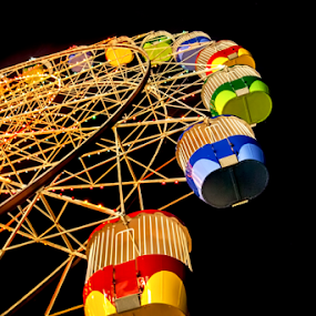 Ferris Wheel by Loredana  Smith - Artistic Objects Other Objects ( ride, rollercoaster, rotate, wheel, merry, colorful, sensation, joy, circle, blur, recreation, attraction, dizzy, luna, child, funfair, risk, circular, lunapark, whirligig, happy, carousel, spin, festival, motion, twirl, light, move, ferris, turn, extreme, park, speed, carnival, bulbs, fun, kids, machine, centrifuge, fair, rotating, amusement, fly, centrifugal, night, celebration, high, big )
