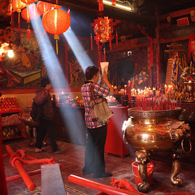 praying by Rully Kustiwa - People Street & Candids ( red, vihara, praying, ray of light, canon eos,  )