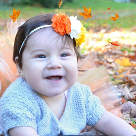 Luna in Leaves by Judy Tomlinson - Babies & Children Child Portraits ( girl, autumn, outdoors, fall, baby, leaves, portrait )