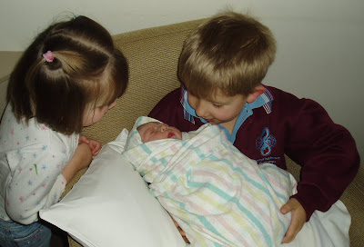 Amelia with her big brother and sister