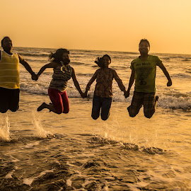The joy of friendship by Ashutosh Tiwari - People Street & Candids ( sea beach, sunset at sea, friends, jumping, sunset at beach, friendship, sea, couple, jump, couples,  )