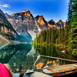 The Rocky Mountain by Joseph Law - Landscapes Mountains & Hills ( blue sky, bushes, boats, rocky mountains, banff national park, morning glory, reflections, trees, lake, log, rocks )