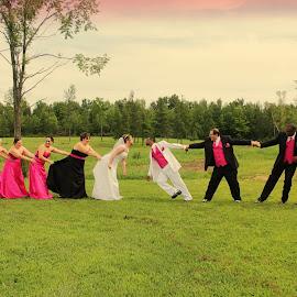 Tug-a-war by Kimmi Walrath Doerr - Wedding Groups ( event, wedding, group fun, men, women, Wedding, Weddings, Marriage )