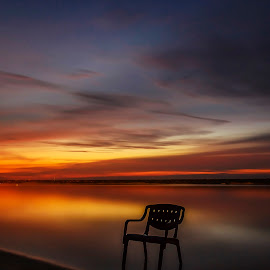Alone against the night by Jee Cornelius - Landscapes Beaches ( clouds, chair, sky, afternoon, beach )