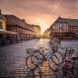 Sunset in the streets by Catalin Tibuleac Fotografie - City,  Street & Park  Street Scenes ( sweden, bikes, sunset, city center, malmo, evening, dusk )