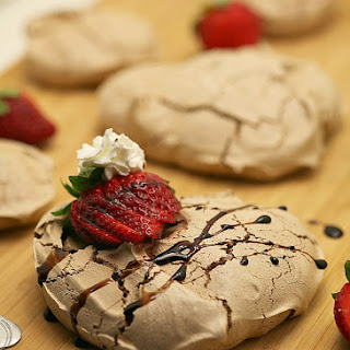 Dark Chocolate Pavlovas with Red Wine Soaked Strawberries and Red Wine Syrup