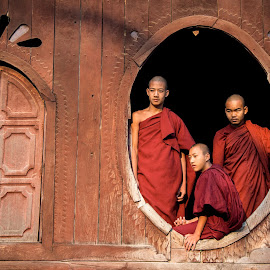 Watching the watchers by Mike O'Connor - People Street & Candids ( religion, buddhism, shan state, myanmar, red, window, monks, three, shweyanpyay monastery, nyaung,  )
