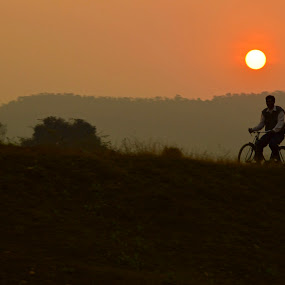 the journey of life... by Jayanti Chowdhury - Landscapes Sunsets & Sunrises ( rider, sunset, journey, road, golden hour )