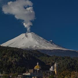 Snowy volcano and church by Cristobal Garciaferro Rubio - Landscapes Travel ( santiago xalizintla, popo, mexico, snow, popocatepetl, eruption, smoking volcano, snowy volcano, smoke )