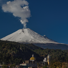Snowy volcano and church by Cristobal Garciaferro Rubio - Landscapes Travel ( santiago xalizintla, popo, mexico, snow, popocatepetl, eruption, smoking volcano, snowy volcano, smoke )