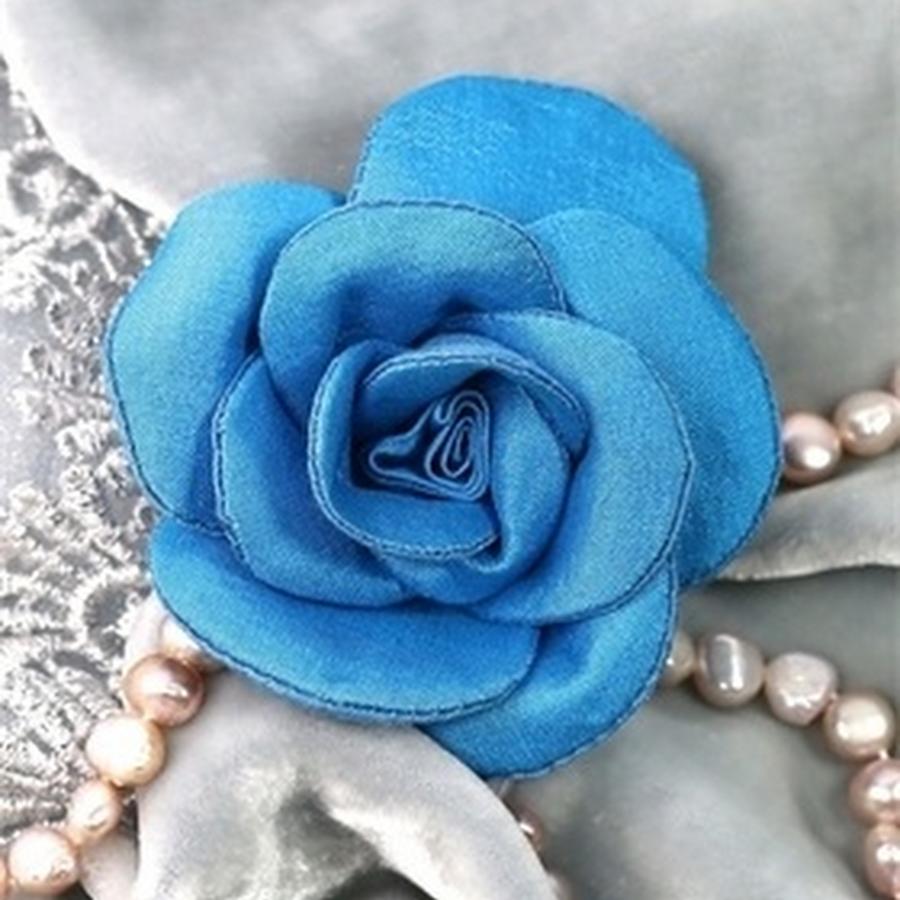 Turquoise silk rose