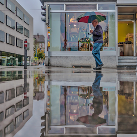 Paddle view! by Jesus Giraldo - City,  Street & Park  Street Scenes ( urban, shop, concept, reflection, colors, street, oldman, beauty, rain, paddle, city )