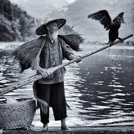 Yangshuo fisherman by Dharmali Kusumadi - Black & White Portraits & People