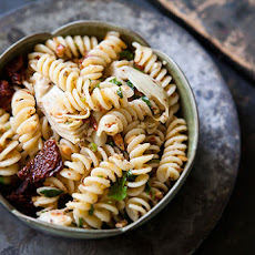 Pasta with Artichoke Hearts, Sun Dried Tomatoes, and Toasted Almonds