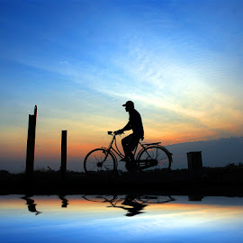 mulih by Indra Prihantoro - Transportation Bicycles ( sunset, sunrise, people, bicycle, blue, orange. color )