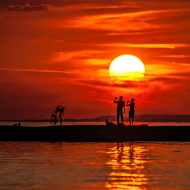 Sunset for two! by Jesus Giraldo - Landscapes Sunsets & Sunrises ( reflection, concept, red, zoom, colors, sunset, couple, people )