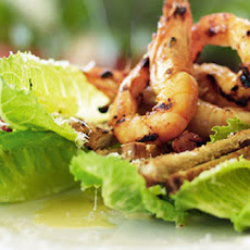 Classic Caesar salad with BBQ chilli prawns