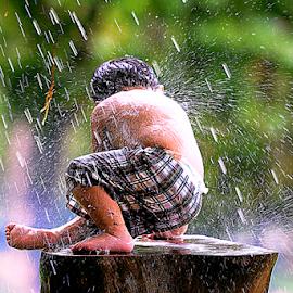 Playing to Rain by Doeh Namaku - Babies & Children Children Candids