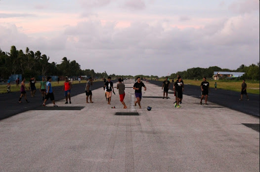 As there are very few flights to Tuvalu- no more than four weekly - the airstrip is used as a football field by locals.