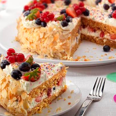 Birthday Cake with Cream and Fresh Fruit