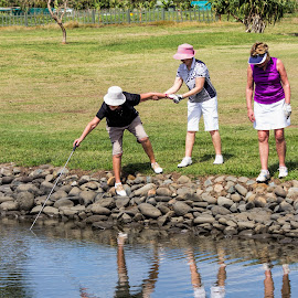 Don't fall in by Vibeke Friis - Sports & Fitness Golf ( woman golfers, fishing for ball,  )