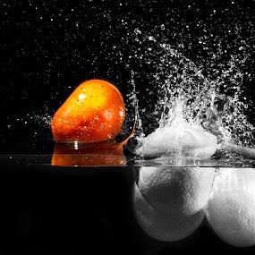 Kinda orange by Todd Wallarab - Food & Drink Fruits & Vegetables ( water, orange, splash, food, wet,  )