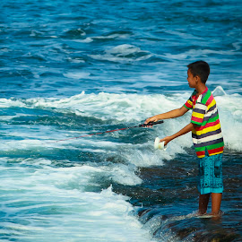 boy were fishing by Jodistira Gencai gerard - People Street & Candids ( child, fishermen, beaches, child candid, candids, boys, candid, beach, fishing, fisherman, boy )