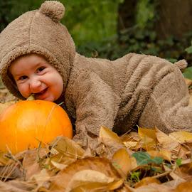 Sofia and pumpkin by Aris Canis von Furcsoara - Babies & Children Babies ( baby portrait, baby with pumpkin, babygirl, baby in nature, autum colours, baby girl, baby into the woods, baby, little baby, baby bear,  )