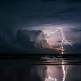 Distant Rumble by Jack Miller - Landscapes Weather ( thunder, water, sand, reflection, nsb, thunderstorm, ocean, beach, storm, coast, lightning, strike, fl, florida,  )