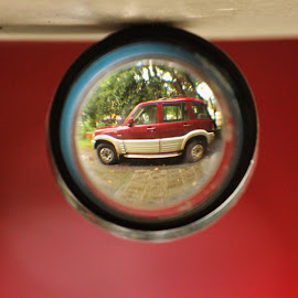Got squeezed into a circle ! by Anoop Namboothiri - Artistic Objects Glass ( red suv, mahindra, abstract, torch lens, lens, creativity, manipulation, scorpio, experiment, suv, artistic, glass, anoop namboothiri, automobole,  )