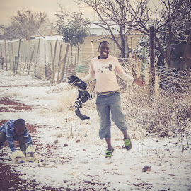 Snow in Africa by Amanda Barg - City,  Street & Park  Neighborhoods ( township, johannesburg, happy, snow, weather )