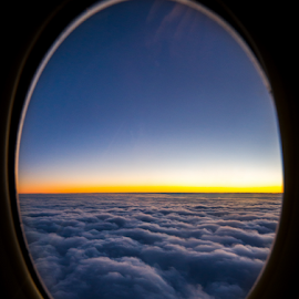 Bull's eye by Cosmin Stahie - Transportation Airplanes ( clouds, sky, window, sunset, hublou, airplane, inside, bull's, glass, above, eye )