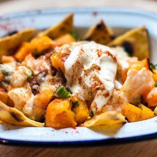 Pumpkin Nachos with shredded pork and pumpkin salsa
