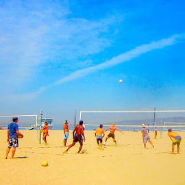 The Volleyball Game, Santa Monica, CA by Ronnie Caplan - Sports & Fitness Other Sports ( clouds, humanity, sand, ball, society, volleyball, santa monica, horizon, ocean, beach, net, people, city, urban, athletes, mountains, sky, blue, lifestyle, men, crowd )