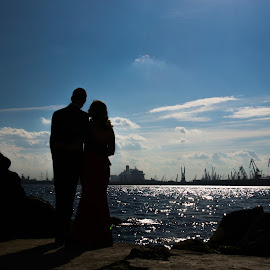 Together by Dan Daniel - People Couples ( sky, blue, silhouette, sea, couple,  )