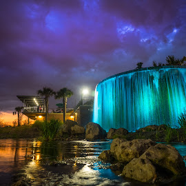 by John Smith - City,  Street & Park  Fountains ( clouds, water, orange, stream, purple )