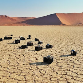 Cameras on Cracked Mud by Rick Venter - Instagram & Mobile Android