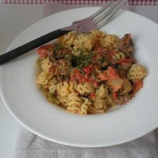 Farfalle with Italian sausage, tomatoes and cream