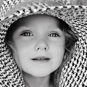 Beautiful Girl in B & W by Cheryl Korotky - Black & White Portraits & People ( hats, child, outlined iris, model, a heartbeat in time photography, amazing faces, wide brimmed hats, nevaeh, b & w, beautiful children, portrait,  )