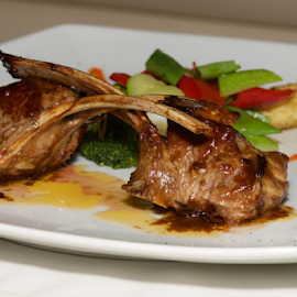 Lamb cutlets with vegetables on white plate by Nick Dale - Food & Drink Meats & Cheeses ( haute cuisine, peppers, main course, green, potatoes, white, vegetables, plate, lamb, restaurant, dinner, cutlets, red, food, broccoli, entree, gourmet, china )