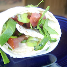 Hummus Wrap With Tomatoes and Spinach