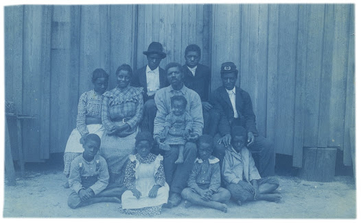 "This poignant photograph depicts a multi-generational black family in Calhoun, Alabama. The Emancipation Proclamation, together with the Thirteenth Amendment passed in 1865, meant that they and all African Americans would live ""henceforth and forever free."""
