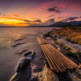 Rakik Bambu by Mediia Hendriko - Landscapes Sunsets & Sunrises ( clouds, nature, sunset, lake, travel, landscapes )